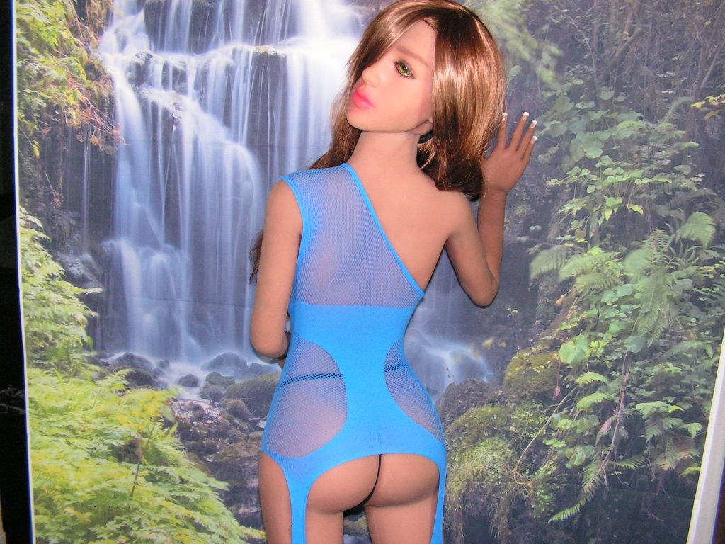 The super sexy electric blue mesh body suit looks fantastic on Tracie. She is showing off a little m